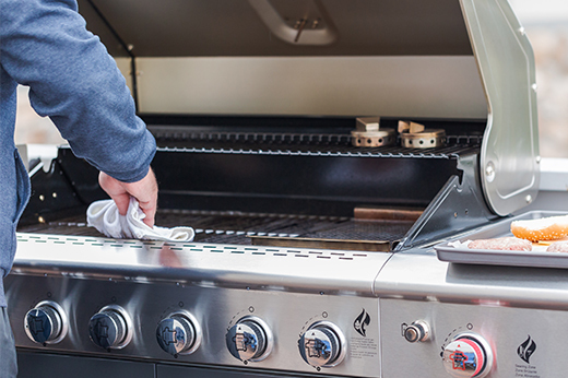 Man cleaning a grill
