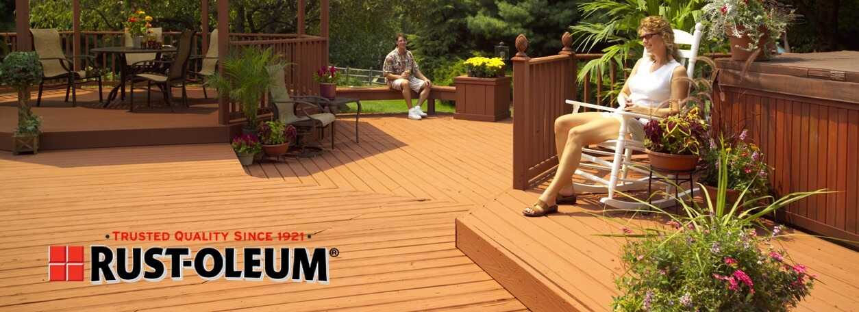 Person sitting on deck with Rust-oleum logo